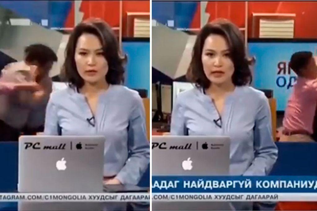 La presentadora estaba dando el noticiero cuando dos trabajadores comenzaron a pelearse.
