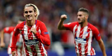 Atletico's Antoine Griezmann, left, celebrates after scoring the opening goal during a Champions League group C soccer match between Atletico Madrid and Chelsea at the Wanda Metropolitano stadium in Madrid, Spain, Wednesday, Sept. 27, 2017. (AP Photo/Fran